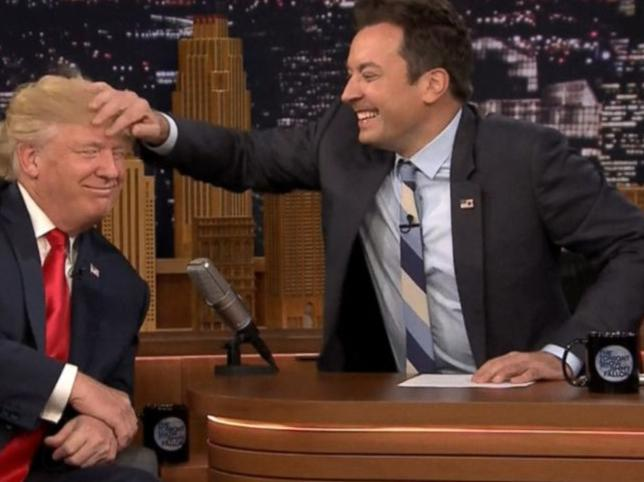 Jimmy Fallon musses Donald Trump's hair in his controversial 2016 interviewYouTube/screengrab