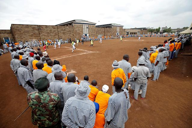 <p>Kenyan prisoners line up to watch a mock World Cup soccer match between Russia and Saudi Arabia at the Kamiti Maximum Security Prison, Kenya's largest prison facility, near Nairobi, on June 14, 2018. (Photo: Baz Ratner/Reuters) </p>