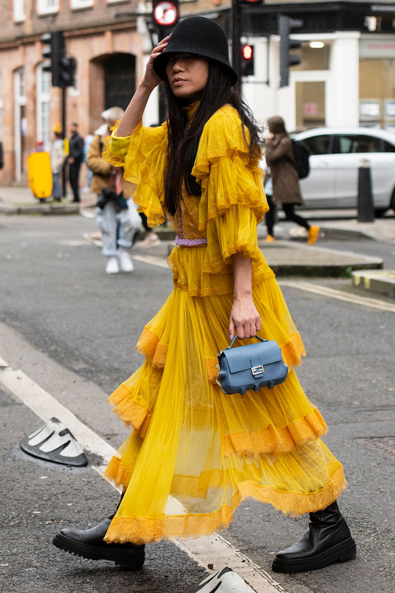 <p>Give maxis that little extra 'something something' by experimenting with different materials and silhouettes. This tiered sunshine yellow mesh dress with a ruffled trim is a case in point.</p>