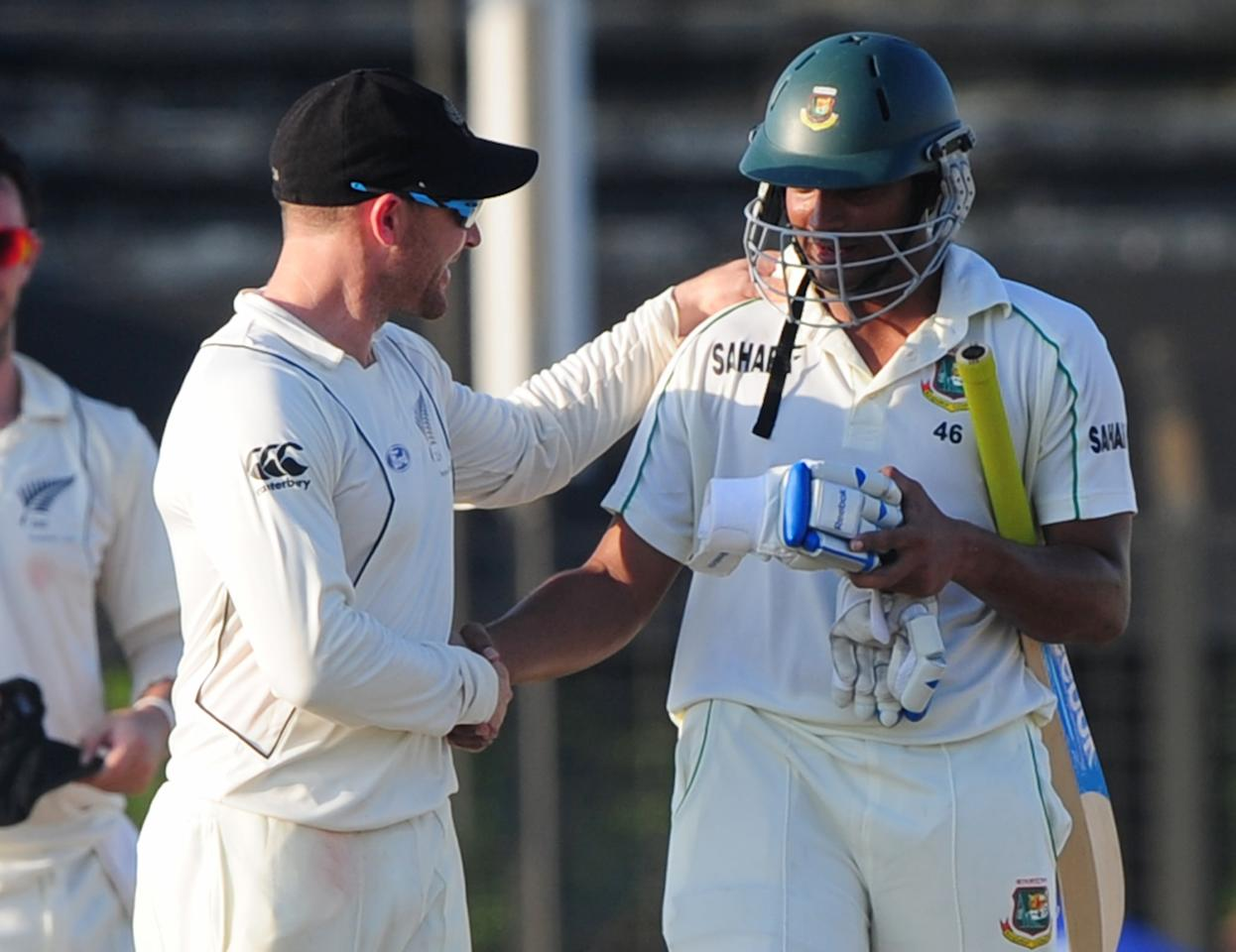 Bangladesh batsman Shakib Al Hasan (R) shakes hands with New Zealand cricket captain Brendon McCullum (L) after the fifth and final day of the first cricket Test match between Bangladesh and New Zealand at The Zahur Ahmed Chowdhury Stadium in Chittagong on October 13, 2013. AFP PHOTO/Munir uz ZAMAN        (Photo credit should read MUNIR UZ ZAMAN/AFP/Getty Images)