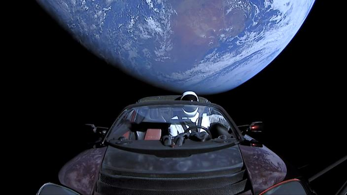 "SpaceX's spacesuit-clad ""Starman"" dummy sits in the driver's seat of a Tesla Roadster while orbiting Earth after launching aboard a Falcon Heavy rocket on February 6, 2018."