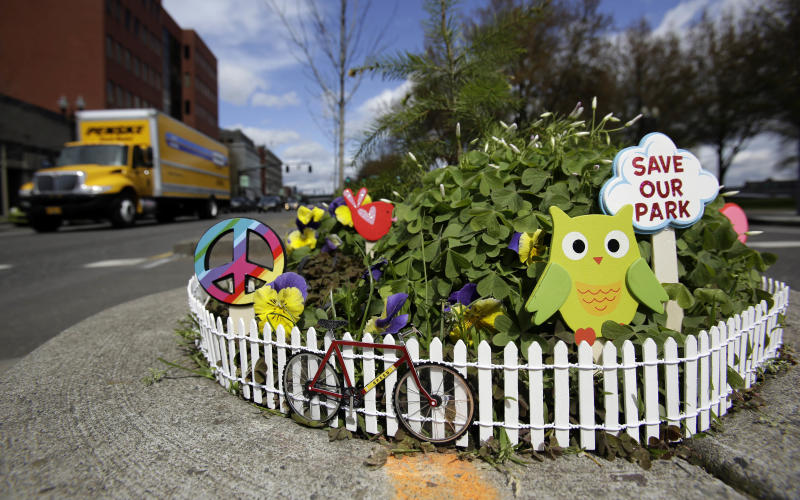 Mill Ends Park sports a myriad of colorful decorations in Portland, Ore., Thursday, April 11, 2013. Tiny battle lines are being drawn in a whimsical British-American dispute over which country has the world's smallest park. Two feet in diameter, Portland's Mill Ends Park holds the title of world's smallest park in the Guinness Book of World Records. But a rival has emerged--Prince's Park, more than 5,000 miles away in the English town of Burntwood which holds the record for smallest park in the United Kingdom.(AP Photo/Don Ryan)