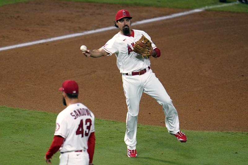 Los Angeles Angels third baseman Anthony Rendon makes an off-balance throw to put out Arizona Diamondbacks' Nick Ahmed at first base during the fifth inning of a baseball game Wednesday, Sept. 16, 2020, in Anaheim, Calif. (AP Photo/Marcio Jose Sanchez)