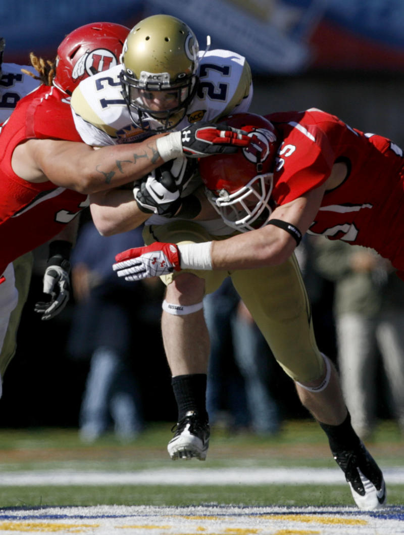 Utah's John Cullen, left, and Greg Bird tackle Georgia Tech's Preston Lyons during the second quarter in the Sun Bowl NCAA college football game on Saturday, Dec. 31, 2011, in El Paso, Texas. Utah won 30-27 in overtime. (AP Photo/The Salt Lake Tribune, Trent Nelson) DESERET NEWS OUT; LOCAL TV OUT