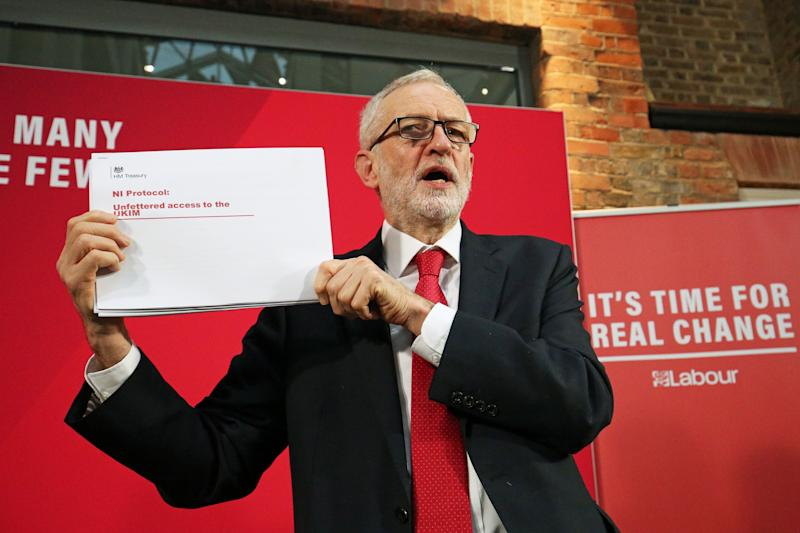 Labour Party leader Jeremy Corbyn holds up a leaked document relating to Northern Ireland, during a press conference in central London, whilst on the General Election campaign trail. (Photo: PA Wire/PA Images)