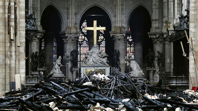 Charred debris in front of the altar at Notre-Dame cathedral in Paris in the aftermath of a devastating blaze which destroyed the monument's roof (AFP Photo/LUDOVIC MARIN)