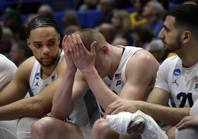 <p>Marquette's Joey Hauser, middle, covers his face as teammates Theo John, left, and Joseph Chartouny, right, sit next to him during the second half of a first-round game against Murray State in the NCAA men's college basketball tournament Thursday, March 21, 2019, in Hartford, Conn. Murray State won 83-64. (Elise Amendola/AP) </p>