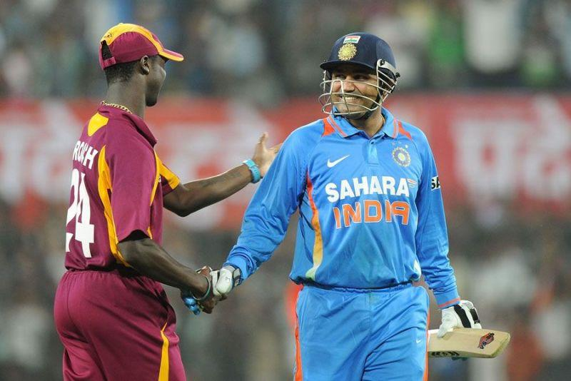 Kemar Roach congratulating Virender Sehwag for his epical 219 runs knock