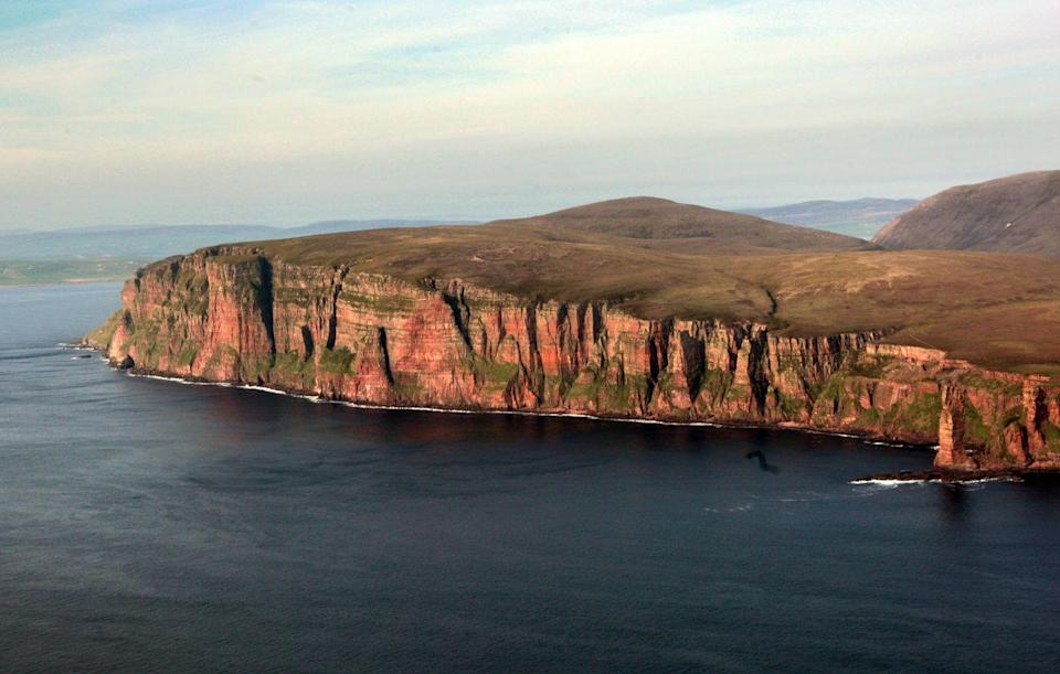 """<p>Take a ferry from the Scottish mainland to visit Hoy, which has dramatic coastlines. Hoy has a huge and varied bird life, along with several landmarks like the Dwarfie Stane, a rock-cut tomb. Fun fact: The 1984 video for the Eurythmics' """"Here Comes the Rain Again"""" was shot here. </p>"""