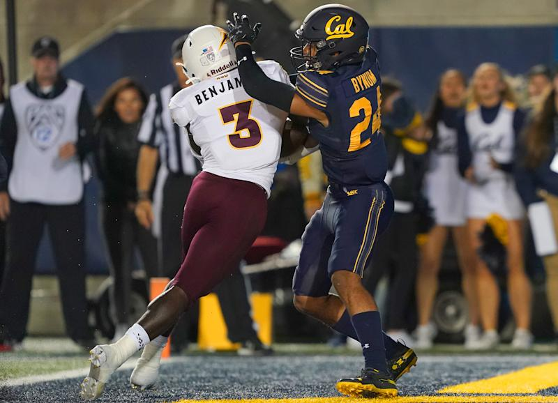 BERKELEY, CALIFORNIA - SEPTEMBER 27: Eno Benjamin #3 of the Arizona State Sun Devils scores a touchdown pushing Camryn Bynum #24 of the California Golden Bears into the endzone during the first quarter of an NCAA football game at California Memorial Stadium on September 27, 2019 in Berkeley, California. (Photo by Thearon W. Henderson/Getty Images)