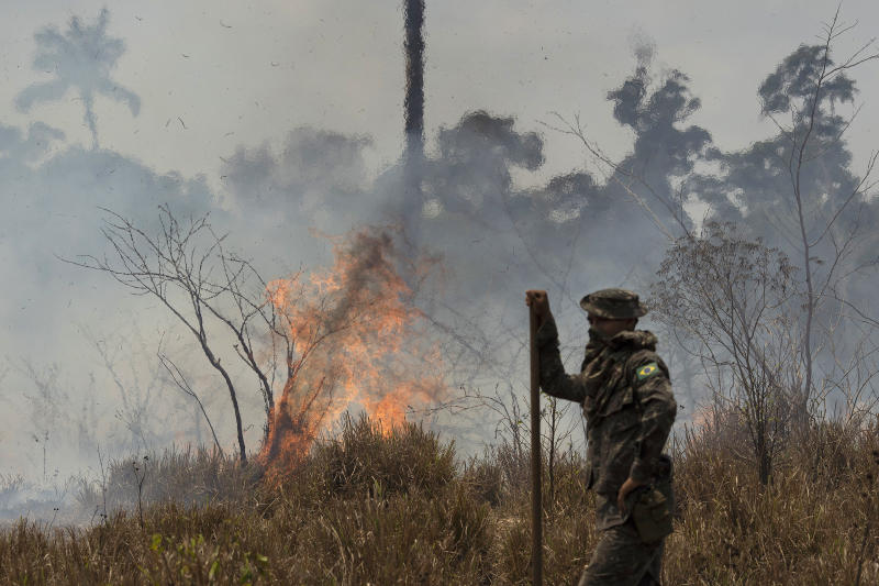 A Brazilian soldier takes a quick rest before resuming to fight fires at the Nova Fronteira region in Novo Progresso, Brazil, Tuesday, Sept. 3, 2019. Brazilian President Jair Bolsonaro sent the military to help extinguish some fires. Last week, he passed a decree banning most fires for land-clearing for a period of 60 days, although he later limited the ban to the Amazon. (AP Photo/Leo Correa)