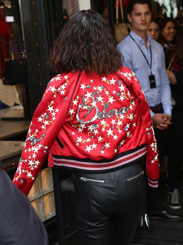 "<p>The back of the jacket features customized embroidery, reading ""Selena"" in sequins. (Photo: Splash) </p>"