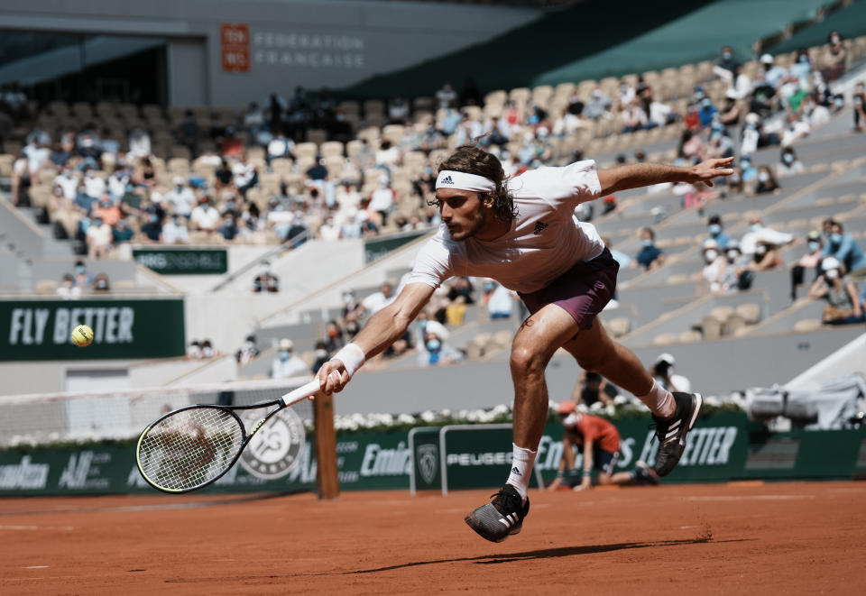 Stefanos Tsitsipas of Greece plays a return to Spain's Pablo Carreno Busta during their fourth round match on day 8, of the French Open tennis tournament at Roland Garros in Paris, France, Sunday, June 6, 2021. (AP Photo/Thibault Camus)
