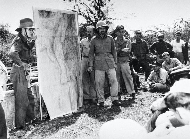 General Orde Wingate (wearing pith helmet), commander of the Chindits, briefs members of the 1st Air Commando, USAAF