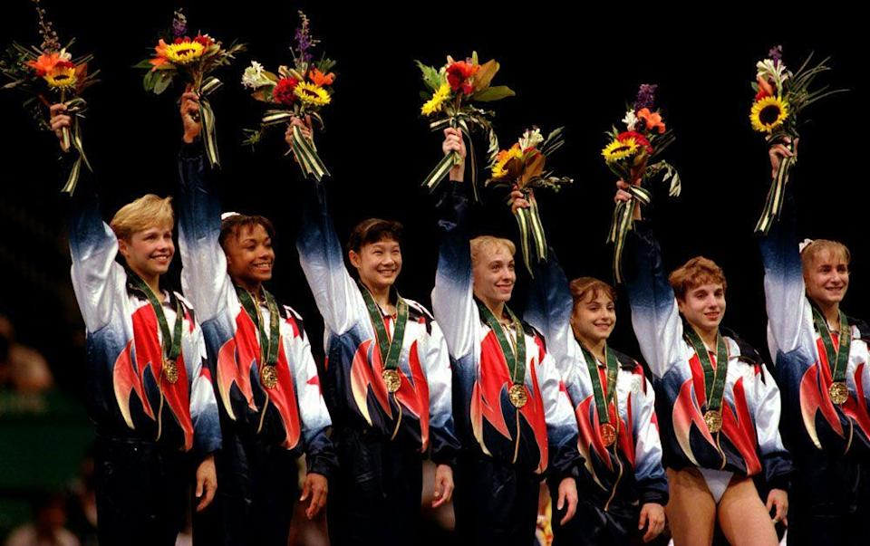 <p><em>Amanda Borden, Dominique Dawes, Amy Chow, Jaycie Phelps, Dominique Moceanu, Kerri Strug, Shannon Miller</em></p><p>Windbreakers required; pants optional. </p><p>(Really, Kerri Strug broke her ankle landing her final vault of the team competition and couldn't get her foot through the leg of her track pants.) </p>