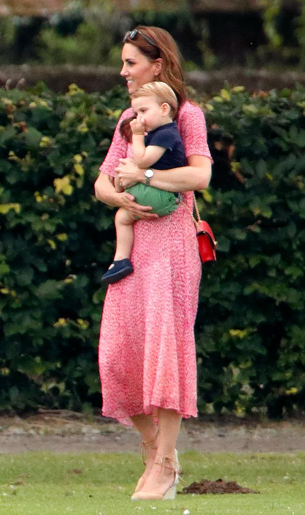 """The mother-of-three wore a £325 LK Bennett dress for a family trip to the polo which promptly sold out. She accessorised the ensemble with her go-to pair <a href=""""https://fave.co/2NinS1Z"""" rel=""""nofollow noopener"""" target=""""_blank"""" data-ylk=""""slk:Castañer wedges"""" class=""""link rapid-noclick-resp"""">Castañer wedges </a>and a punchy Mulberry cross-body bag. [Photo: Getty]"""