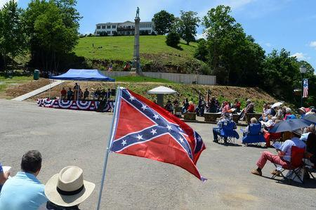 Local, county and state elected officials attend a dedication ceremony in Brandenburg, Kentucky, U.S. May 29, 2017 for a Civil War Confederate Soldier Memorial recently removed from the campus of the University of Louisville. REUTERS/Bryan Woolston