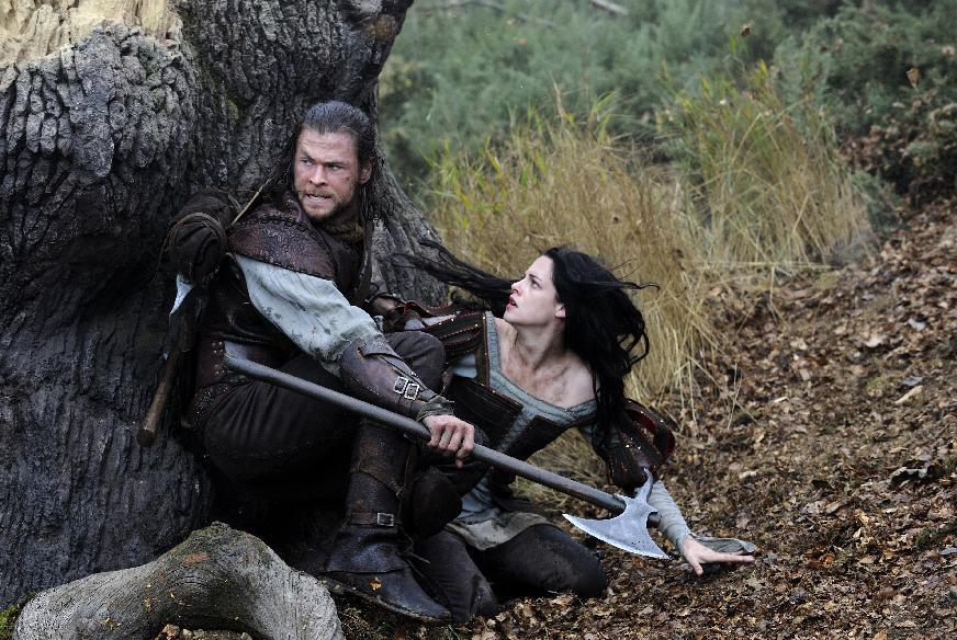 "This film image released by Universal Pictures shows Chris Hemsworth, left, and Kristen Stewart in a scene from ""Snow White and the Huntsman"". (AP Photo/Universal Pictures, Alex Bailey)"