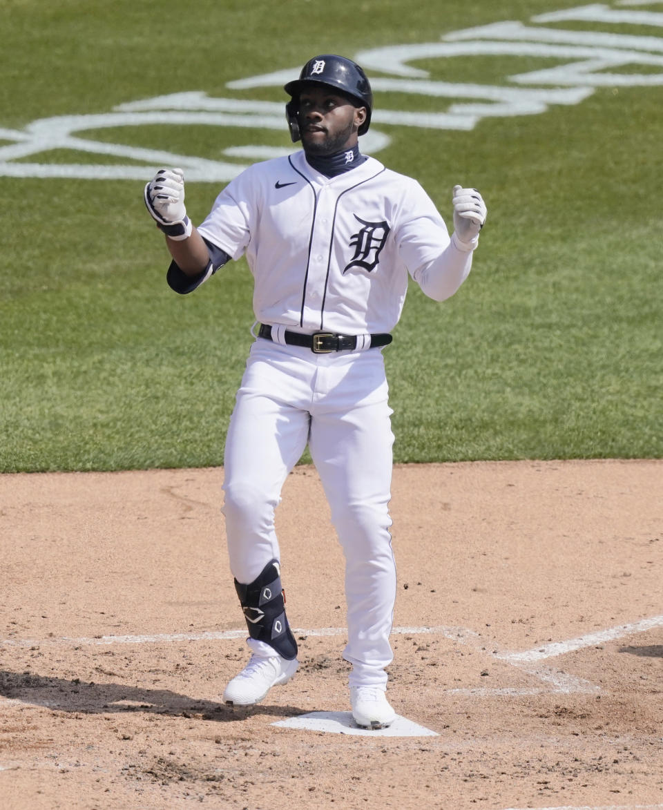 Detroit Tigers' Akil Baddoo reacts at home plate after his solo home run during the third inning of a baseball game against the Cleveland Indians, Sunday, April 4, 2021, in Detroit. (AP Photo/Carlos Osorio)