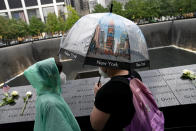 Visitors browse the south pool at the National September 11 Memorial & Museum, Thursday, Sept. 9, 2021, in New York. (AP Photo/John Minchillo)