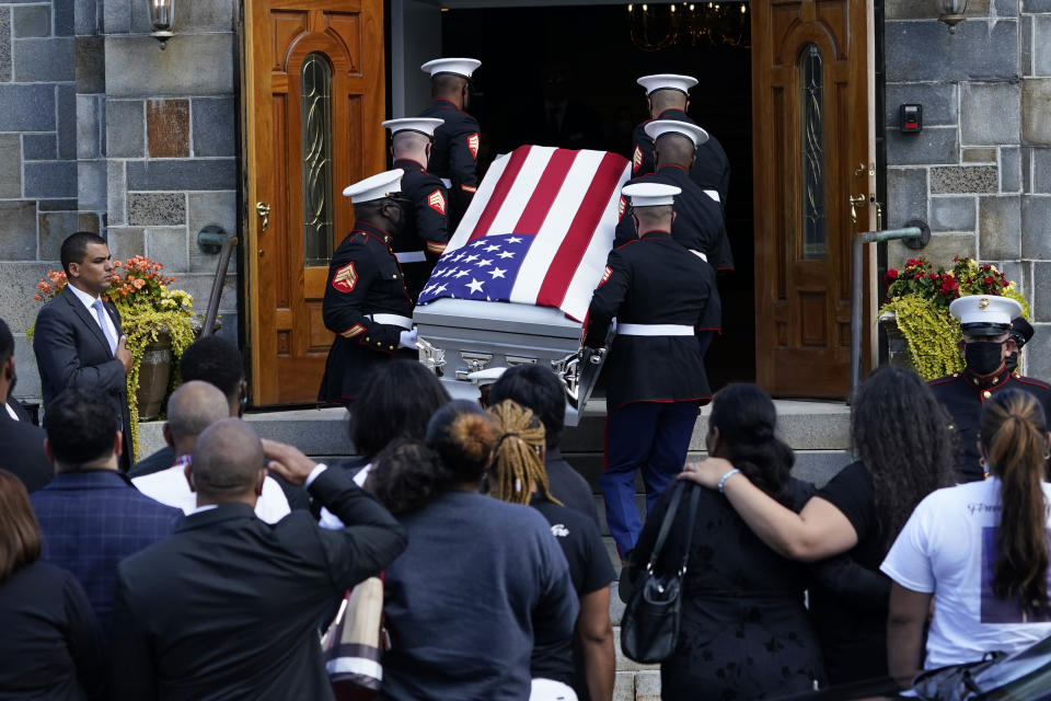 The casket of Sgt. Johanny Rosario Pichardo, a U.S. Marine who was among 13 service members killed in a suicide bombing in Afghanistan, is carried into the Farrah Funeral Home in her hometown of Lawrence, Mass, Saturday, Sept. 11, 2021. (AP Photo/Robert F. Bukaty)