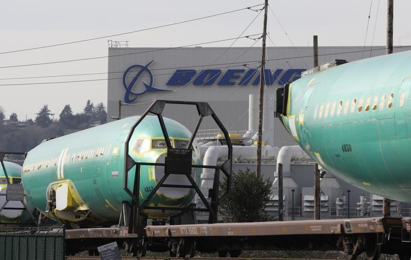 Boeing 737 fuselages are delivered by train to a Boeing manufacturing site in Renton