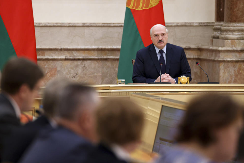 Belarusian President Alexander Lukashenko speaks during an expanded meeting of the Constitutional Commission in Minsk, Belarus, Tuesday, Sept. 28, 2021. The authoritarian leader of Belarus announced a referendum on a new constitution in Feb. 2022 and promised not to let the opposition come to power. Alexander Lukashenko told a government meeting Tuesday he had drafted a new constitution that redistributes powers between the main branches of the government and establishes a new governing body, the All-Belarus People's Assembly. (Maxim Guchek/BelTA photo via AP)