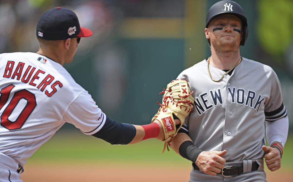 New York Yankees' Clint Frazier is tagged out attempting to steal by Cleveland Indians' Jake Bauers in the third inning of a baseball game, Sunday, June 9, 2019, in Cleveland. (AP Photo/David Dermer)
