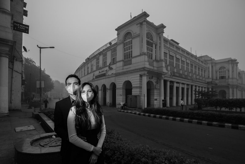 The unidentified couple are shown surrounded by thick smog. Photo: Banjara Studios