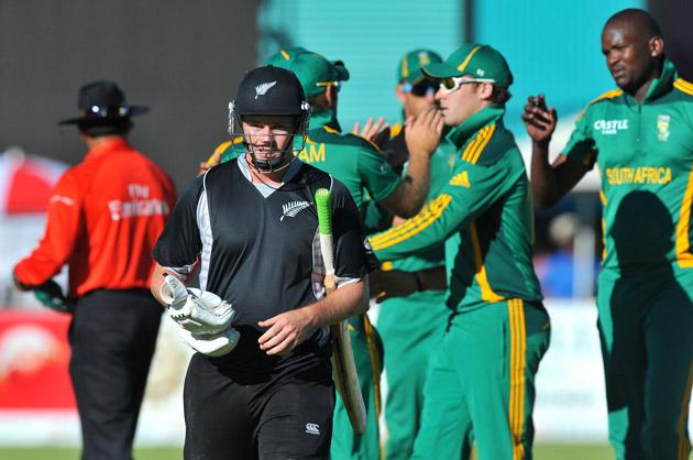 Colin Munro of New Zealand walks off for 9 runs caught by Colin Ingram during the 2nd One Day International match between South Africa and New Zealand at De Beers Diamond Oval on January 22, 2013 in Kimberley, South Africa.(Photo by Duif du Toit/Gallo Images/Getty Images)