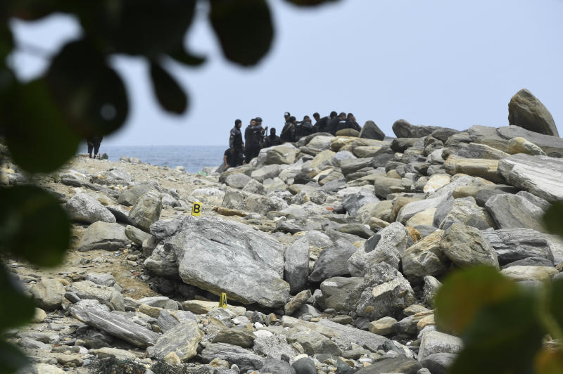 Security forces inspect a coastal area in La Guaira, Venezuela, Sunday, May 3, 2020. Interior Minister Nestor Reverol said on state television that Venezuelan forces overcame an armed maritime incursion by boats from neighboring Colombia before dawn Sunday, in which several attackers were killed and others detained. (AP Photo/Matias Delacroix)