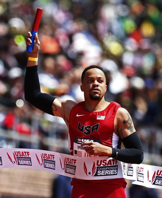 FILE - In this April 25, 2015, file photo, Wallace Spearmon, of the United States, crosses the finish line to win the USA vs. the World men's 4x200-meter relay race at the Penn Relays athletics meet in Philadelphia. The mens 200-meter race at the Drake Relays might turn out to be even closer than the marquee womens hurdle race, with five Olympians and meet record holder Wallace Spearmon in the field. (AP Photo/Rich Schultz, File)
