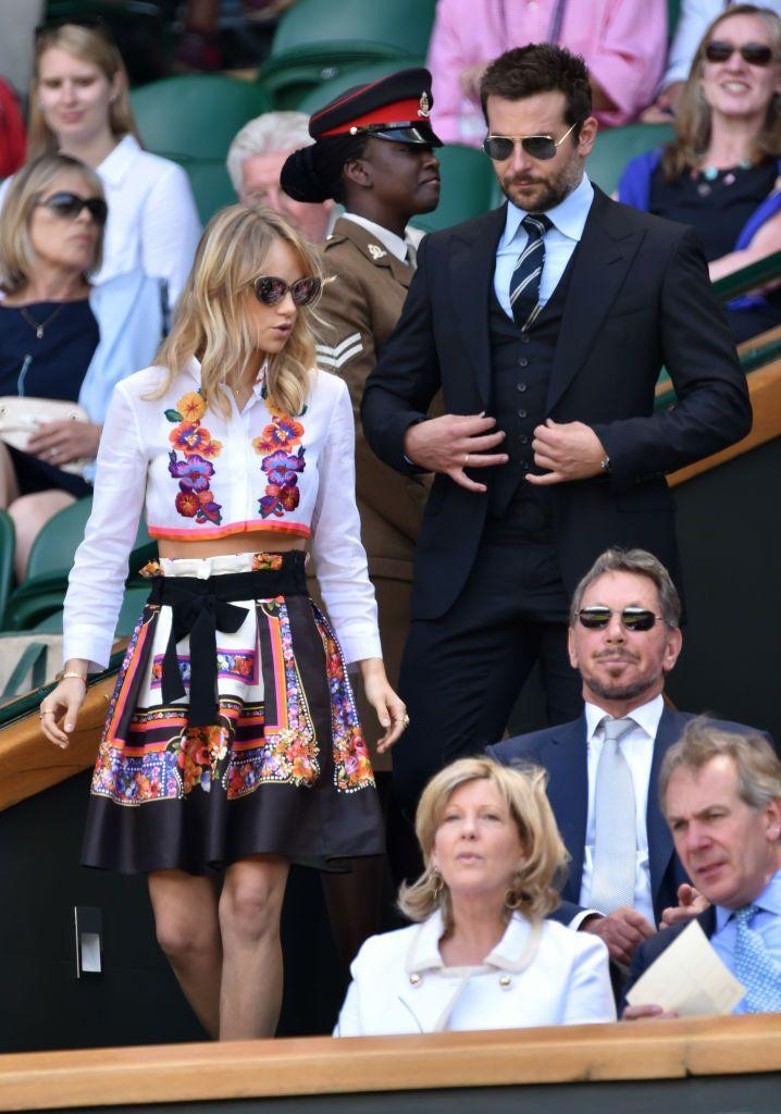 <p>The model and actor wore a two-piece to the sporting event. </p>