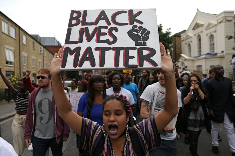 Image result for BLACK WOMEN MARCHING AND PROTESTING