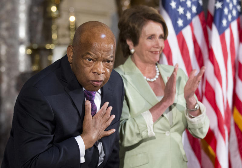Rep. John Lewis, D-Ga., left, with House Minority Leader Nancy Pelosi of Calif., acknowledges the applause during a ceremony on Capitol Hill in Washington on July 31, 2013, in observance of the 50th anniversary of the March on Washington for Jobs and Freedom. (Photo: Manuel Balce Ceneta/AP)