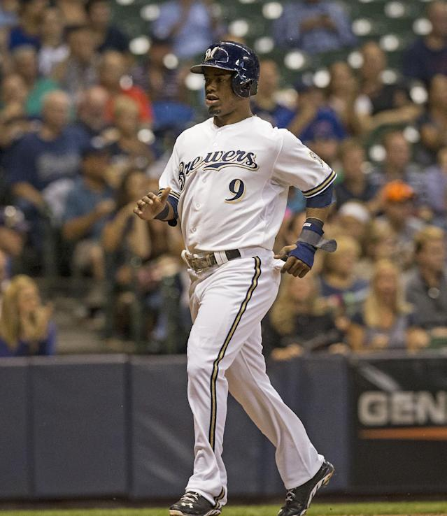 Milwaukee Brewers' Jean Segura crosses home scoring on an RBI-single by Aramis Ramirez during the first inning of a baseball game against the Chicago Cubs, Wednesday, Sept. 18, 2013, in Milwaukee. 2(AP Photo/Tom Lynn)