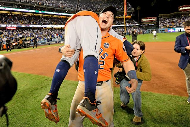 <p>Alex Bregman #2 and Jose Altuve #27 of the Houston Astros celebrate after defeating the Los Angeles Dodgers 5-1 in game seven to win the 2017 World Series at Dodger Stadium on November 1, 2017 in Los Angeles, California. (Photo by Harry How/Getty Images) </p>