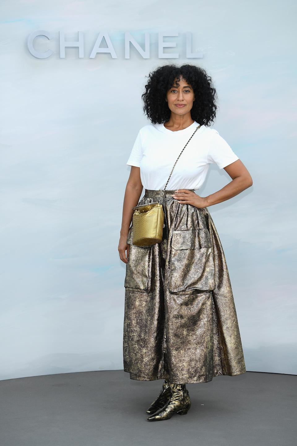 <p>For the Chanel haute couture show in Paris, Tracee Ellis Ross donned a simple tee with an oversized metallic skirt. The actress finished the look with co-ordinating cross-body bag and chunky boots. <em>[Photo: Getty] </em> </p>