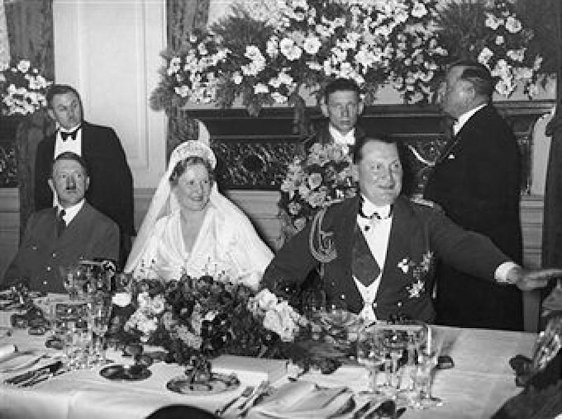 10th April 1935: Prussian premier and Reich Air Minister Hermann Goering (1893 - 1946) (R) and his bride, German actor Emmy Sonnemann (1893 - 1973), are joined by German Fuhrer Adolf Hitler (1889 - 1945) (L) at a banquet table during their wedding reception, Berlin, Germany. (Photo by New York Times Co./Getty Images)