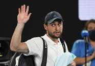 Russia's Aslan Karatsev waves as he leaves Rod Laver Arena after losing his semifinal to Serbia's Novak Djokovic at the Australian Open tennis championship in Melbourne, Australia, Thursday, Feb. 18, 2021.(AP Photo/Andy Brownbill)
