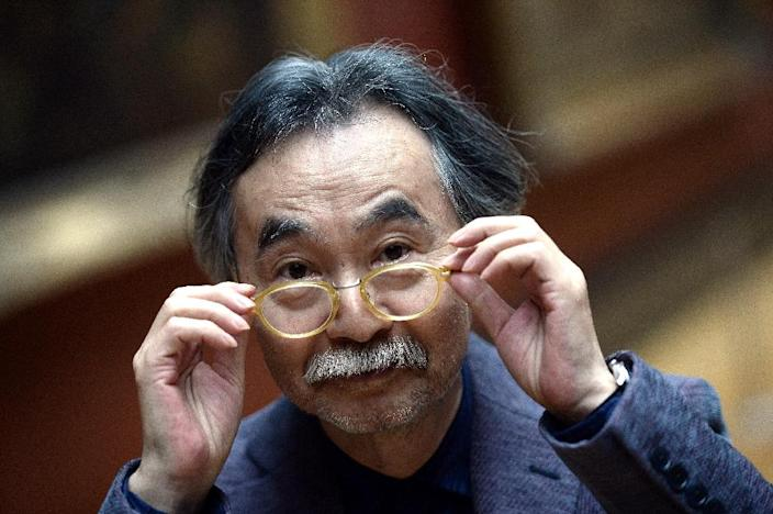 Japanese cartoonist Jiro Taniguchi, whose death his publisher in France announced on February 11, 2017, seen at the Louvre museum in Paris in 2015 (AFP Photo/Stephane de Sakutin)