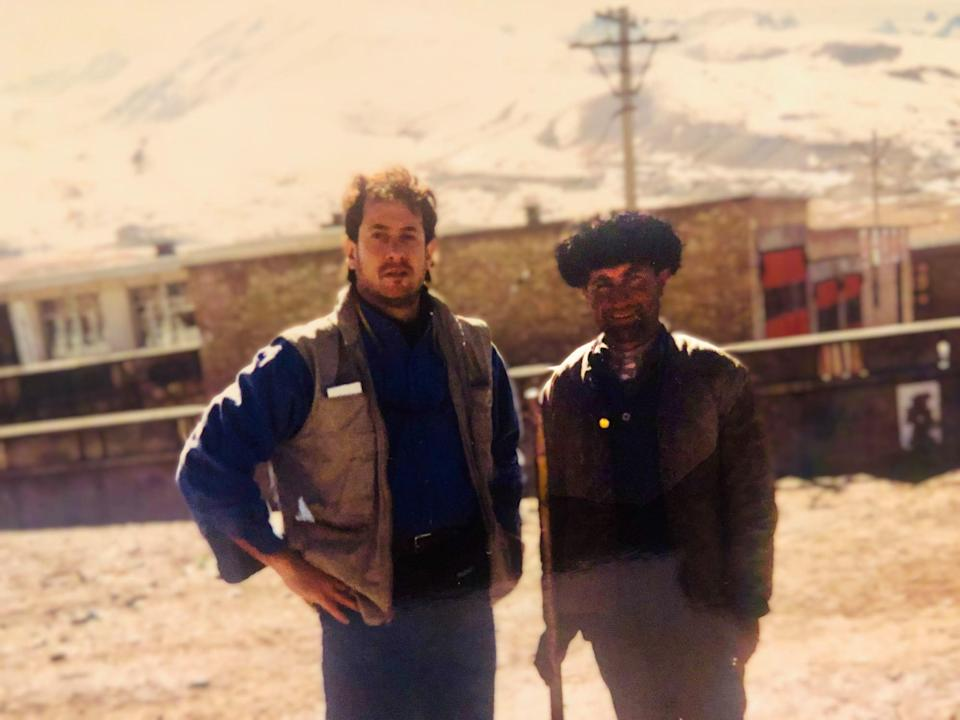 Journalist Josh Meyer, left, reporting from the Pakistan-China border in the 1990s.