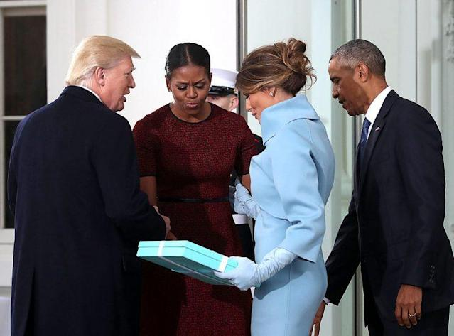 Melania Trump presents a gift from Tiffany's toMichelle Obama. (Photo: Mark Wilson/Getty Images)