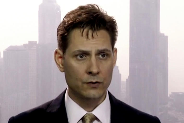 FILE - In this file image made from March 28, 2018, video, Michael Kovrig, an adviser with the International Crisis Group, a Brussels-based non-governmental organization, speaks during an interview in Hong Kong. China lashed out at Canada on Thursday, Feb. 18, 2021, for joining the U.S. and 56 other countries in endorsing a declaration denouncing state-sponsored arbitrary detention of foreign citizens for political purposes. The dispute is rooted in Canada's campaign to free its nationals Kovrig and Michael Spavor, who were arrested more than two years ago by China in apparent retaliation for Canada's arrest days earlier of a top Chinese tech executive, Meng Wanzhou, who is wanted in the U.S. on fraud charges. (AP Photo, File)
