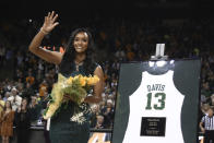 Former Baylor All-American Nina Davis waves to the crowd after having her jersey retired before in an NCAA college basketball game against West Virginia, Saturday, Jan. 18, 2020, in Waco, Texas. (AP Photo/Rod Aydelotte)