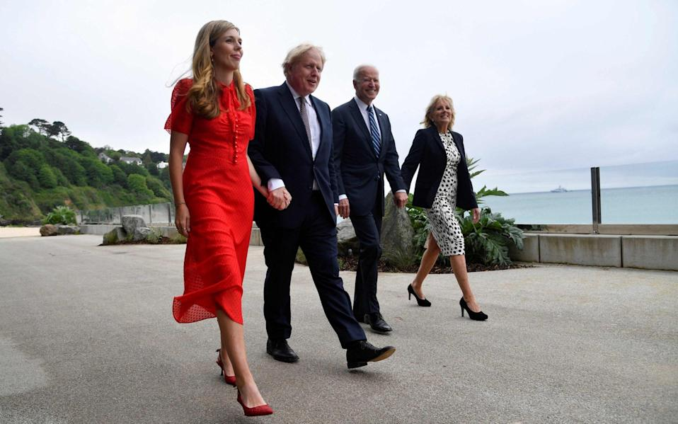 Boris and Carrie Johnson and Joe and Jill Biden stroll together ahead of the G7 summit in Cornwall