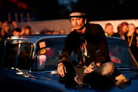 Actor Johnny Depp poses on a Cadillac before presenting his film The Libertine, at Cinemageddon at Worthy Farm in Somerset during the Glastonbury Festival in Britain, June 22, 2017.  REUTERS/Dylan Martinez