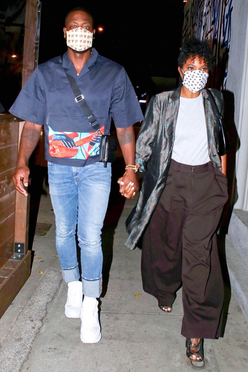 <p>Dwyane Wade and Gabrielle Union were spotted holding hands outside Craigs in West Hollywood, California.</p>