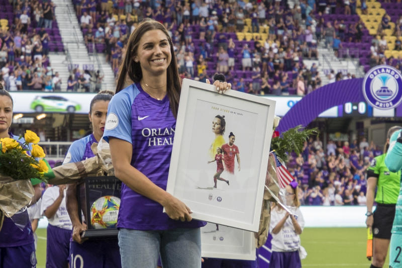 ORLANDO, FL - JULY 20: Orlando Pride forward Alex Morgan (13) is presented with a plaque before during the soccer match between Sky Blue FC and the Orlando Pride on July 20, 2019, at Exploria Stadium in Orlando FL. (Photo by Joe Petro/Icon Sportswire via Getty Images)