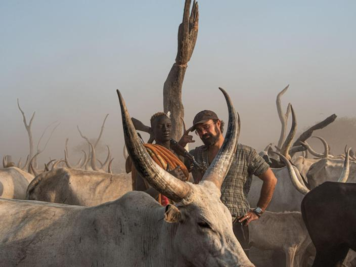 <p>Independent shareholder Evgeny Lebedev meets a herder at a cattle camp in South Sudan</p> (Valentina Morriconi)